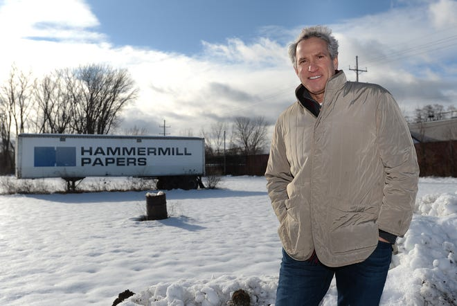 Mitch Hecht, founder and chairman of International Recycling Group, is shown Thursday at the former International Paper property on the south side of East Lake Road. Hecht plans to develop the site into the world's largest plastics recycling plant.