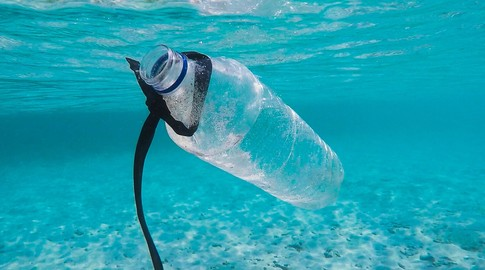 A plastic bottle floating in the ocean.