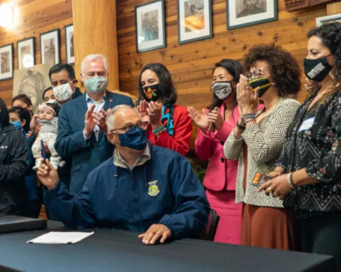 At the Duwamish longhouse, a law is signed requiring environmental justice from state agencies