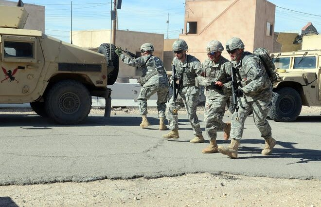 Soldiers participate in an urban patrol training scenario in Ujen, one of the training cities at the Fort Irwin National Training Center in 2016.