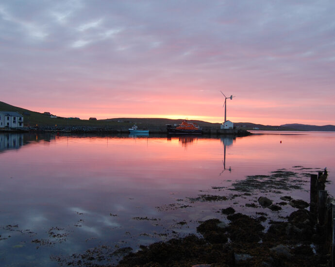 A pink sunset over Aith lifeboat