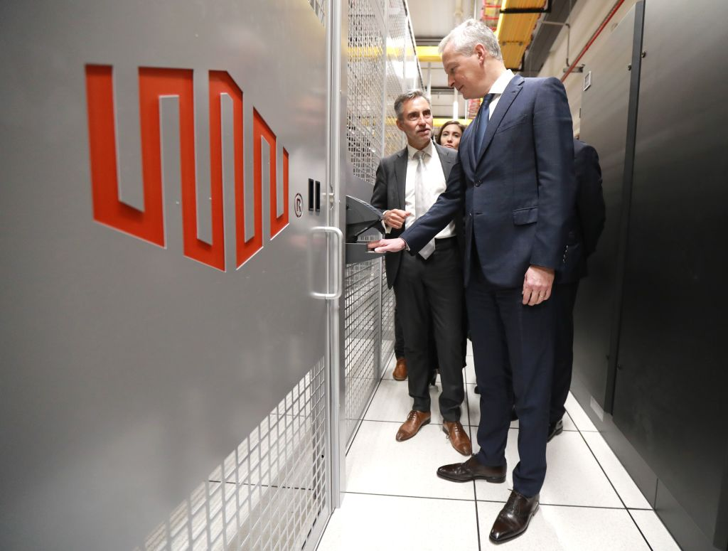 French economy minister Bruno Le Maire (R) is guided by Regis Castagne, managing director of Southern European Equinix Data Center, during the inauguration of the Paris data center called PA8 in the northern Parisian suburb of Pantin in February 2019.