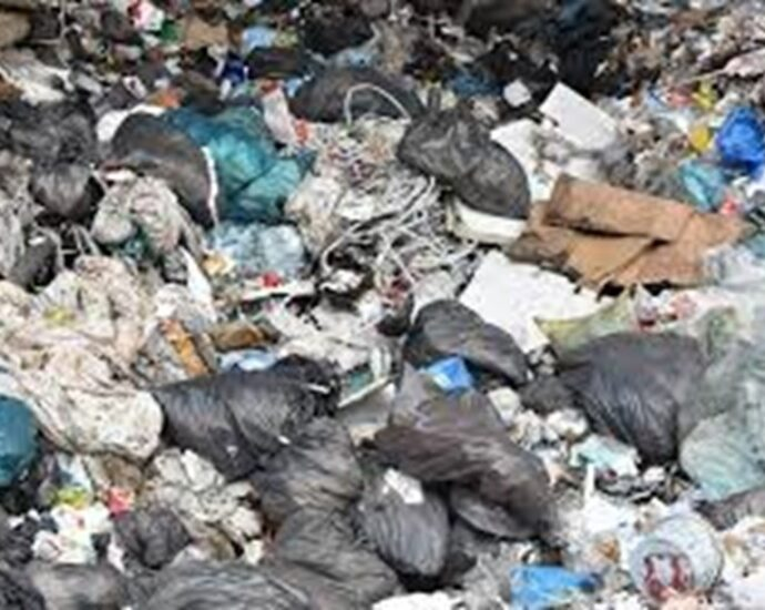 FEATURE-Greener PPE: Inventors tackle COVID-19 plastic waste mountain
