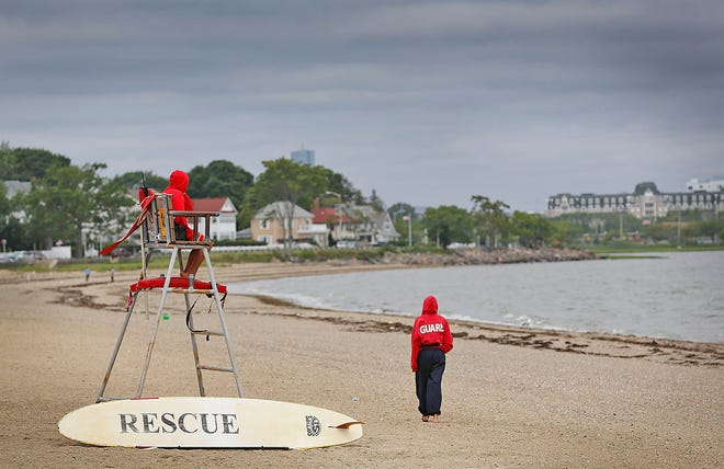 Lifeguards at Wollaston Beach as stormy weather approaches on Thursday, July 8, 2021.