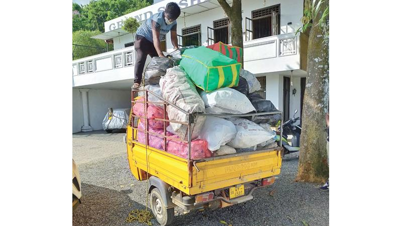 Transporting collected plastic waste.