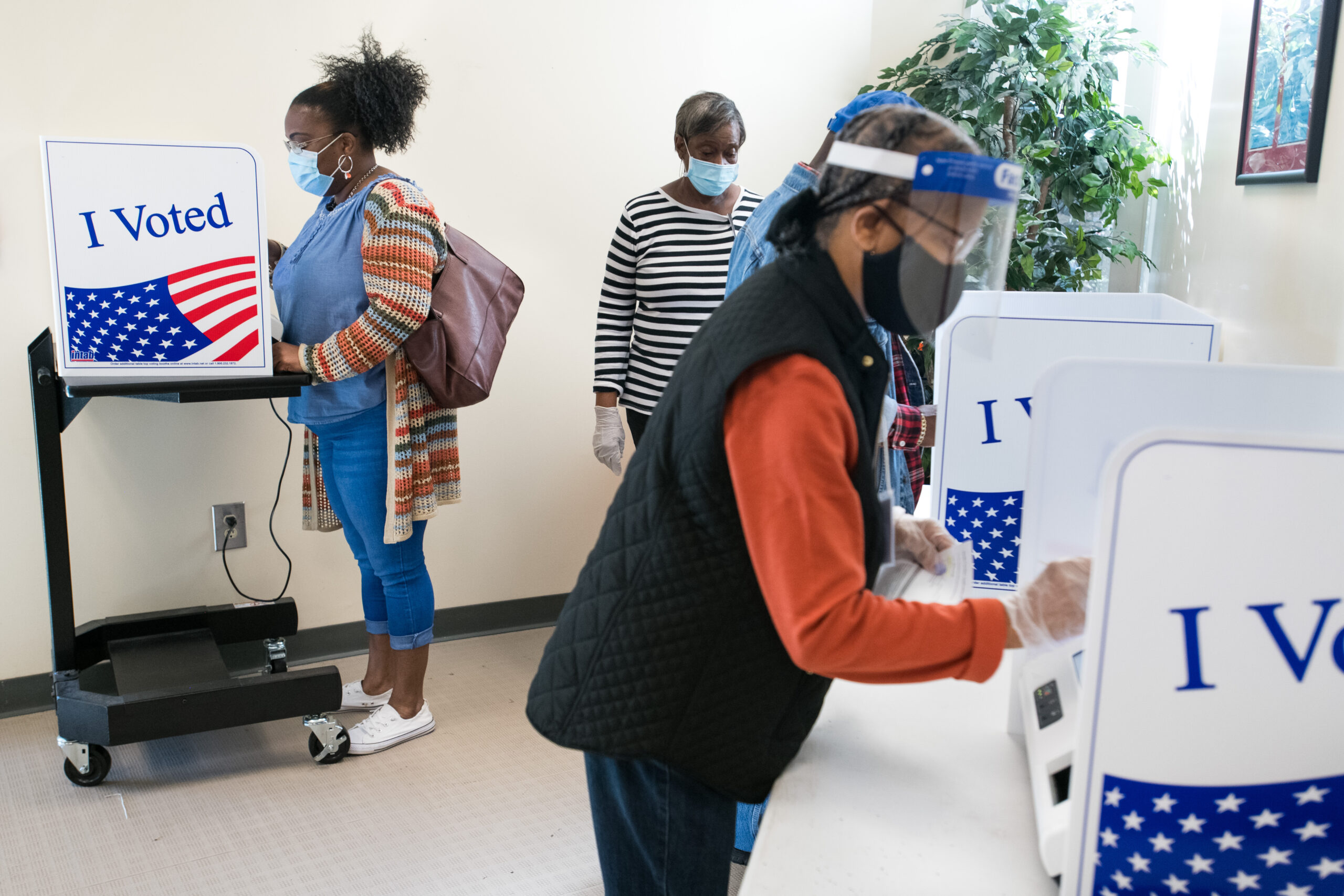 People cast votes at the Richland County Voter Registration and Elections Office on the second day of in-person absentee and early voting on Oct. 6, 2020 in Columbia, South Carolina. Credit: Sean Rayford/Getty Images